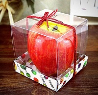 Red-and-yellow apple shaped scented candle