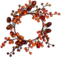 Autumn candle wreath with acorns and berries