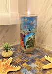 Gel candle with dolphin, starfish and sea shells