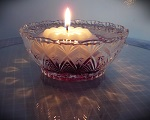 Floating candle in cut glass dish