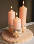 Apricot ribbed candle plate centerpiece with decorated pillar candles