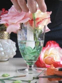 arranging flowers in the glass