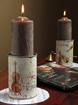 Candle tins decorated with operatic wrapping paper, with brown pillar candles