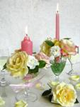 rose and carnation arrangements in wine glasses with pink candles
