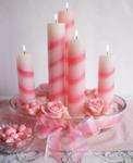 Birthday centerpiece with candy striped candles and roses