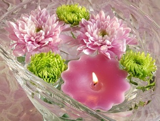 Chrysanthemum and button pom floating candle centerpiece