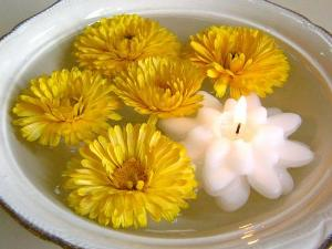 Floating marigolds and white candle