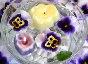 Floating pansies and pansy-shaped candles
