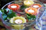Floating wax tealight candle holders