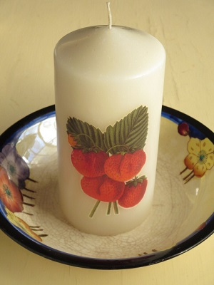 Candle decoupaged with strawberry design