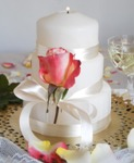 Rose and ribbon wedding cake candle centerpiece