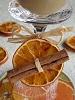 Wine glass decorated with orange slice and cinnamon stick