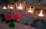 Centerpiece with wine glasses and tea lights